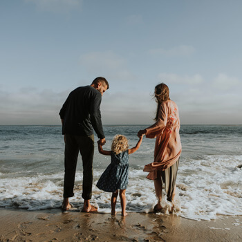Couple with child on beach